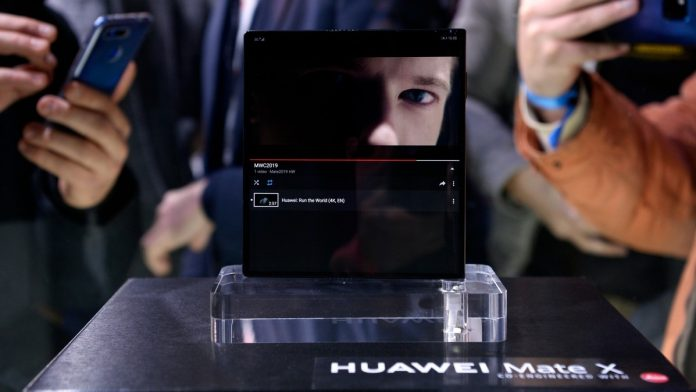Visitors take images of Huawei's new foldable 5G smartphone Huawei Mate X at the Mobile World Congress (MWC), on the eve of the world's biggest mobile fair, on February 24, 2019 in Barcelona. Photo: Josep LAGO/AFP